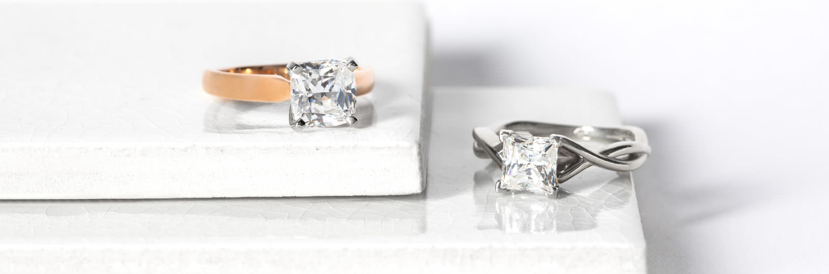 A princess cut and cushion cut engagement ring