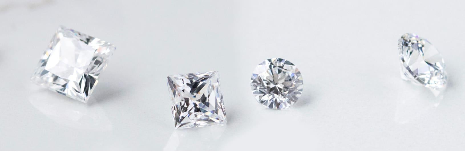 Several round cut and princess cut lab grown diamonds