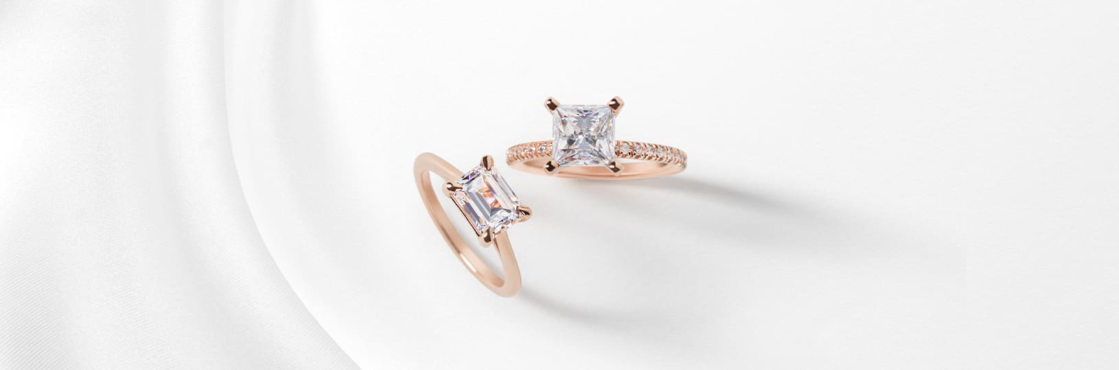 Two rose gold engagement rings
