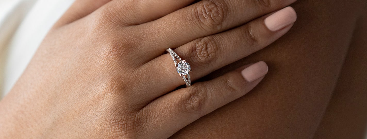Accented round cut diamond engagement ring