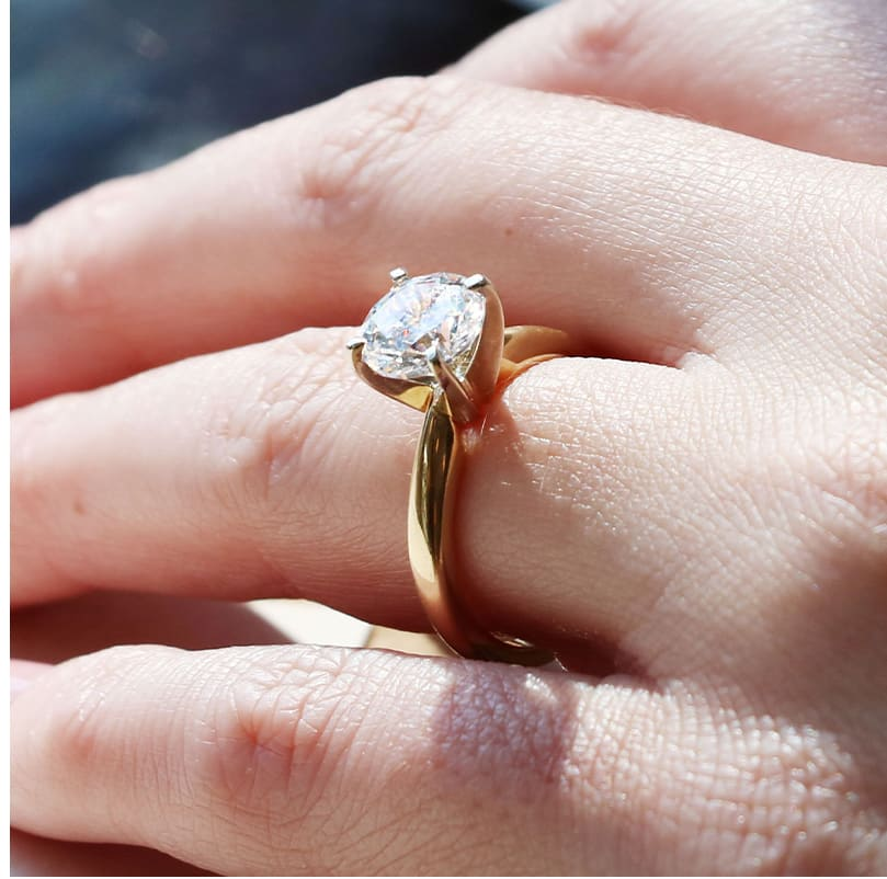 A high profile yellow gold ring