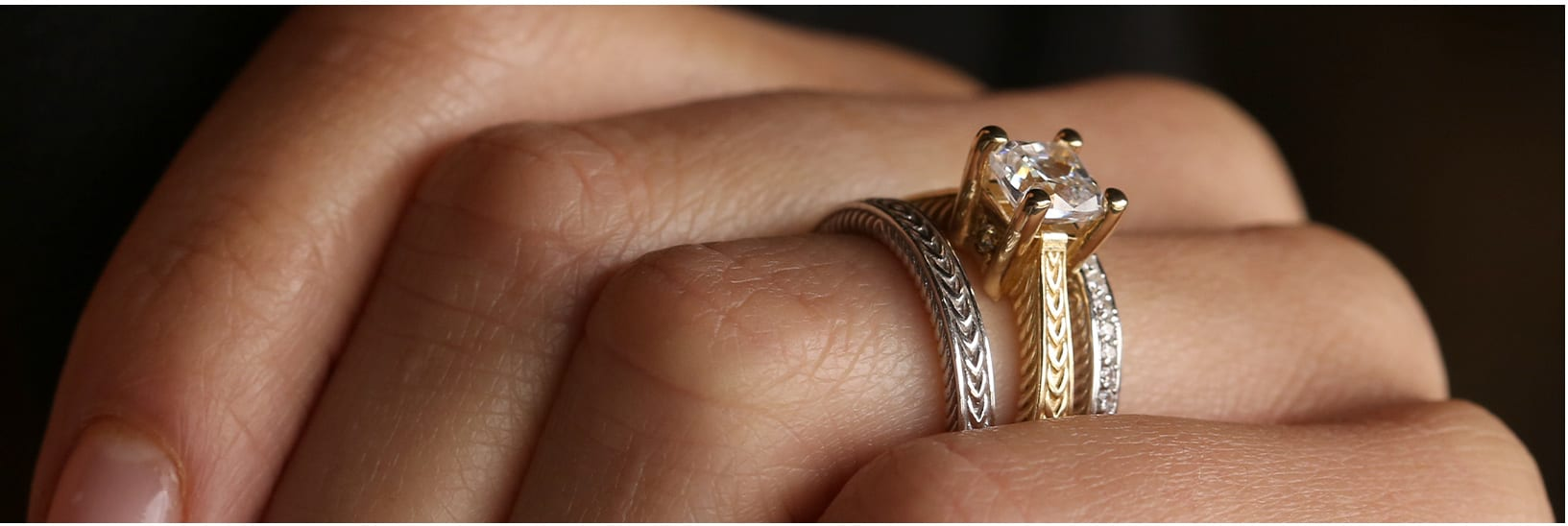 A mixed metal engagement ring stack