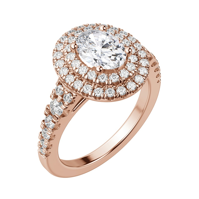 A rose gold halo engagement ring