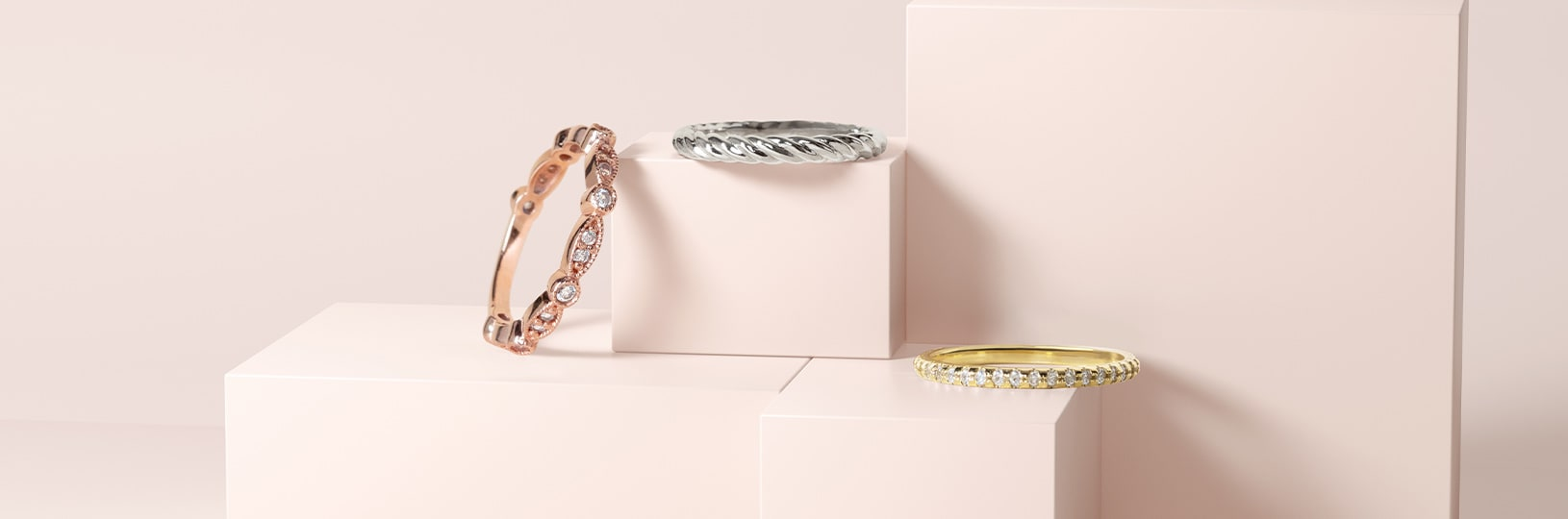 Rose gold, white gold and yellow gold wedding bands compared side by side