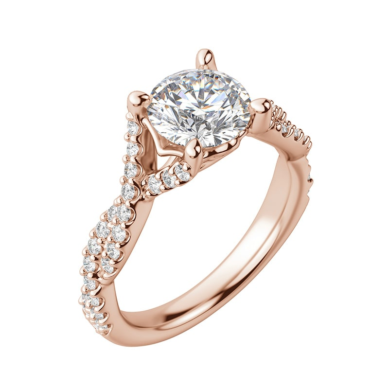 An accented engagement ring featuring a round cut center stone