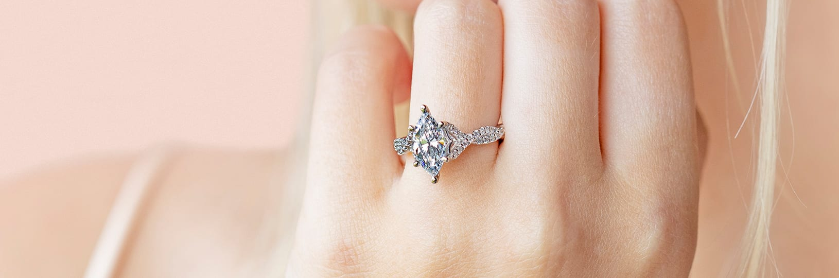 A flashy lab grown marquise cut diamond paired with an accented band.