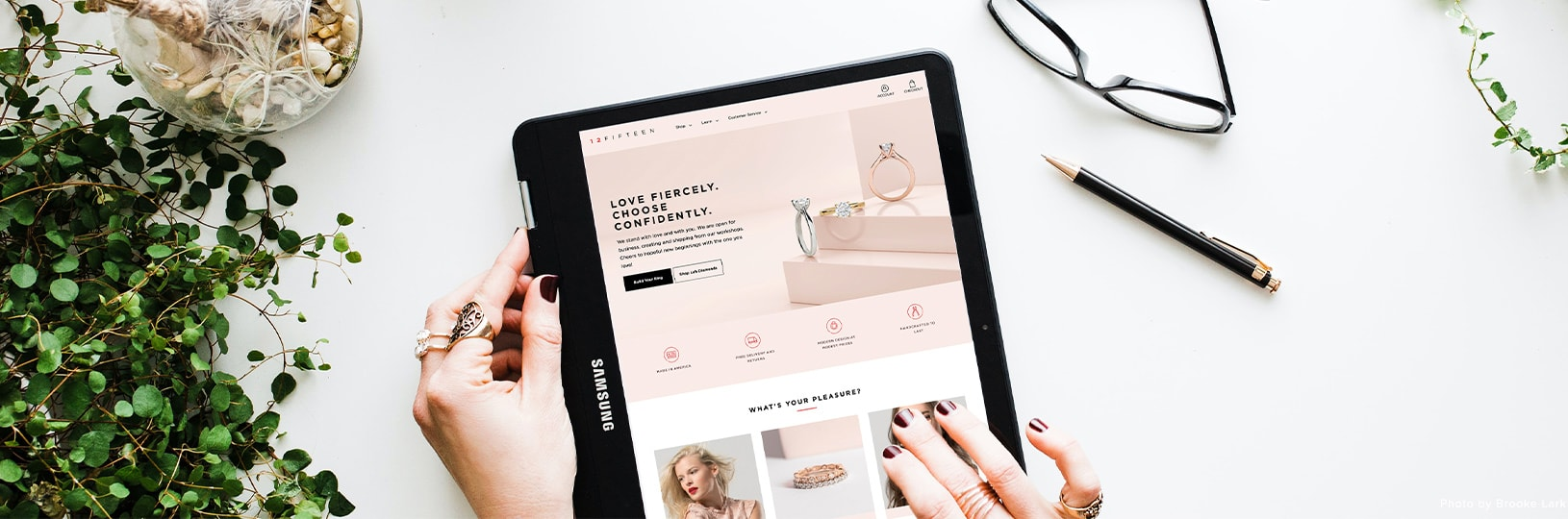 A person browsing engagement rings on their tablet