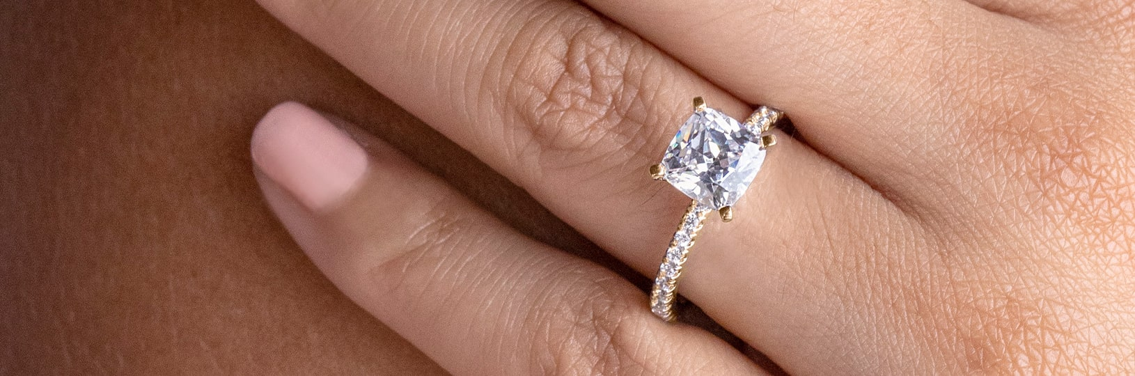 A princess cut stone with an accented band