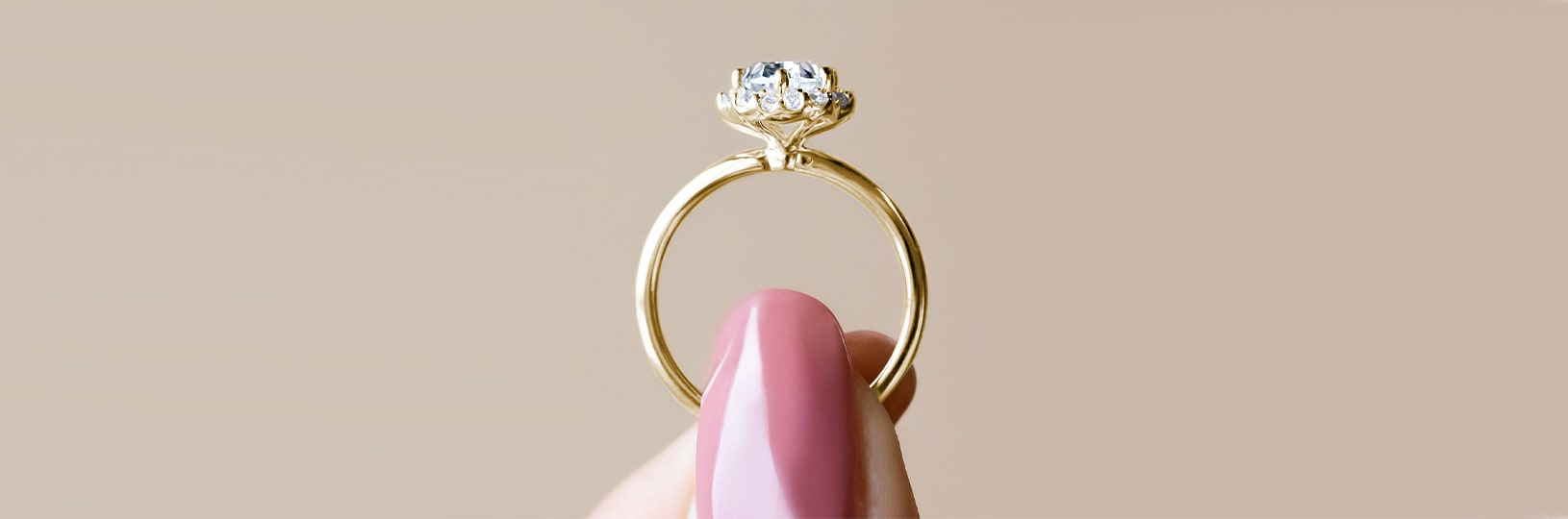 A yellow gold engagement ring in a solitaire setting