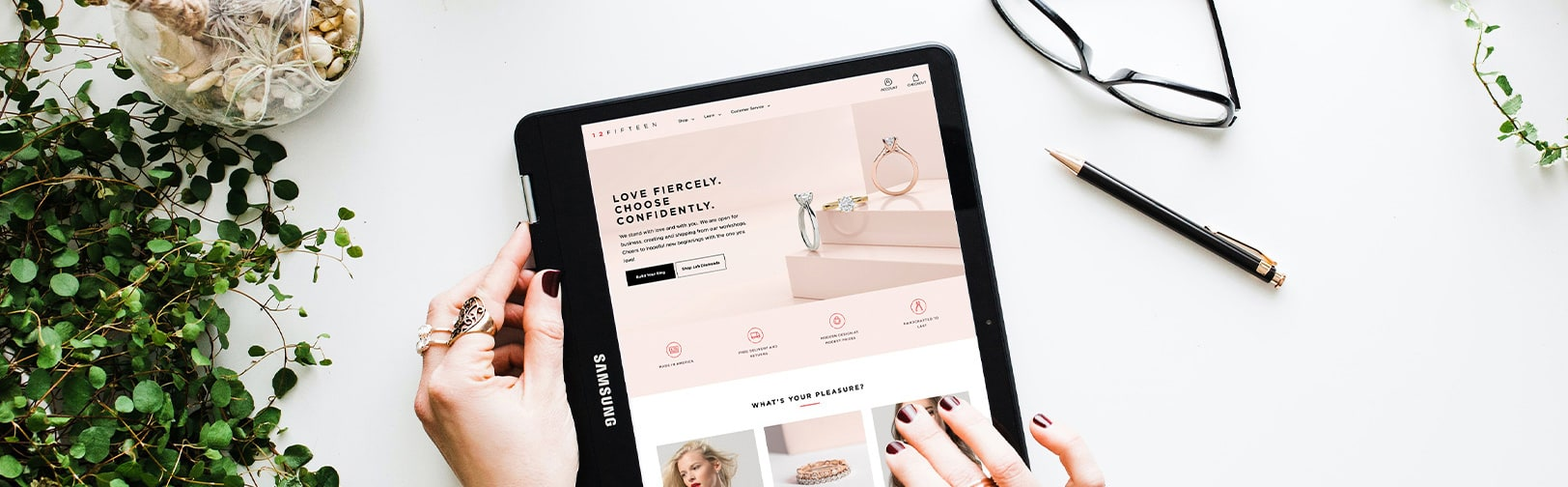 A person searching for fine jewelry using their tablet