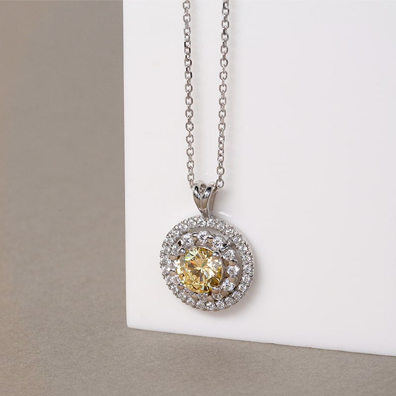 A unique pendant featuring a canary yellow stone