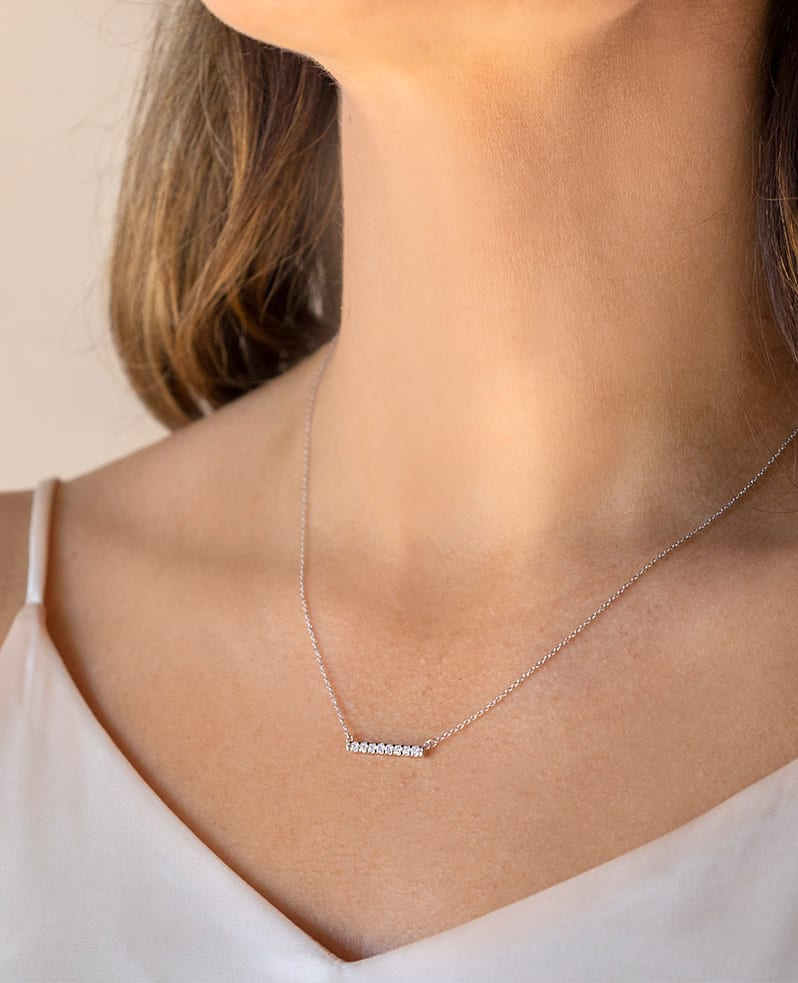 A trendy bar necklace featuring round cut lab grown diamonds