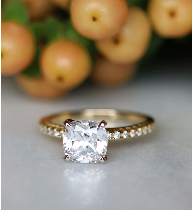 Image of an accented gold engagement ring