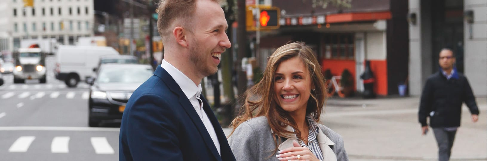Photo of a newly engaged couple walking the city streets