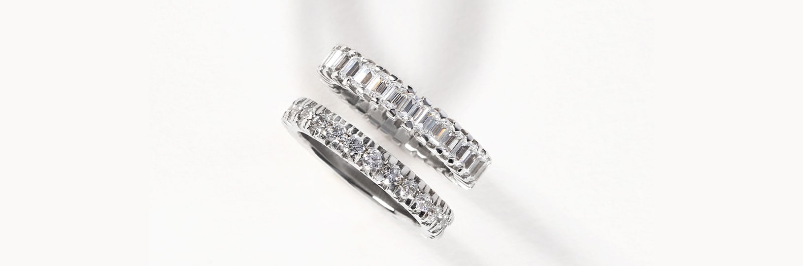 Two accented wedding bands featuring diamond simulants